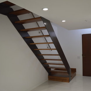 Example of a large trendy wooden floating open staircase design in San Diego