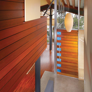 Trendy wooden staircase photo in Orange County