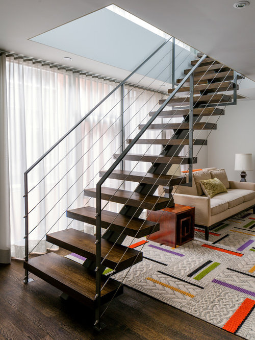 example of a trendy wooden open staircase design in new york