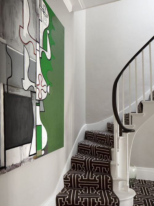 Example Of A Trendy Carpeted Curved Staircase Design In Philadelphia