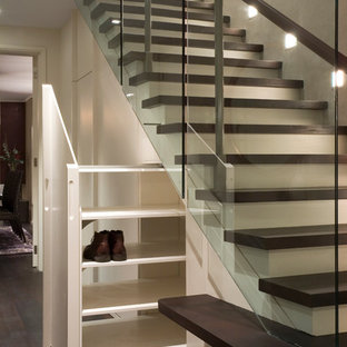 Staircase - contemporary wooden straight staircase idea in London