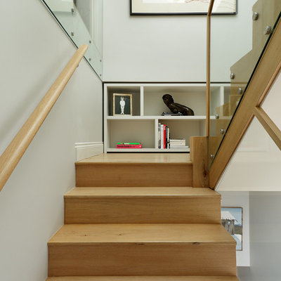 Example of a trendy wooden u-shaped staircase design in London with wooden risers