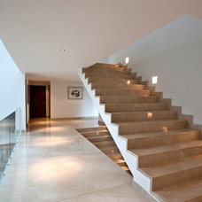 Contemporary Staircase by Grupo MM