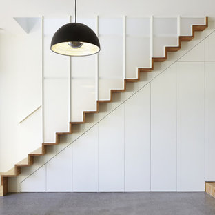 Contemporary wood straight staircase in Melbourne.