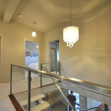 Contemporary Staircase by Revealing Assets - Home Staging Services