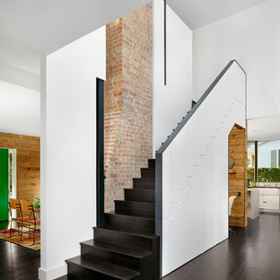 Trendy wooden l-shaped staircase photo in Austin with wooden risers