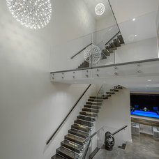Contemporary Staircase by Joshua Lawrence Studios INC
