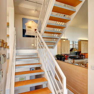 Trendy wooden open staircase photo in Seattle