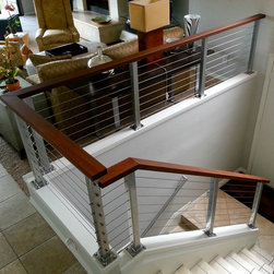 Metallic Powder Coat - Silver posts with hardwood top railings and stainless steel cable---Photo Luke Marshall
