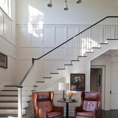 Example of a transitional painted l-shaped staircase design in Other with painted risers