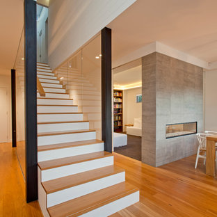Inspiration for a contemporary wooden straight staircase remodel in Sydney with painted risers