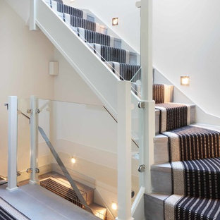 Design ideas for a medium sized contemporary wood l-shaped staircase in London with wood risers.