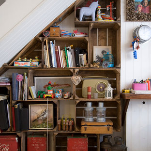 Example of a small cottage chic staircase design in London