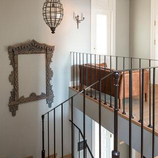 Design ideas for a medium sized mediterranean wood metal railing staircase in London.