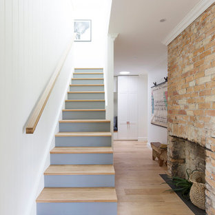 Mid-sized country wood straight staircase in Wollongong with painted wood risers and wood railing.