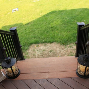 Covered Deck with Built-In Stone Fireplace