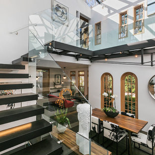 Staircase - eclectic painted floating glass railing staircase idea in San Francisco with painted risers