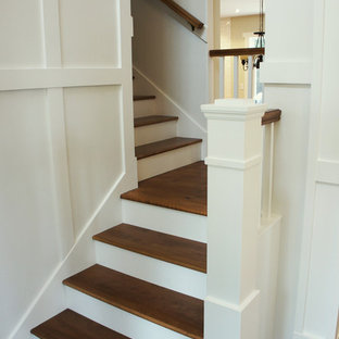 Example of a mid-sized classic wooden l-shaped staircase design in Ottawa with wooden risers