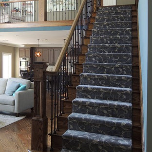 Inspiration for a large craftsman wooden straight mixed material railing staircase remodel in New York with wooden risers