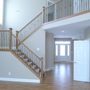 Craftsman stairway with wide painted trim