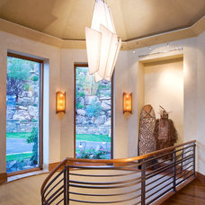 Eclectic Staircase by Charles Cunniffe Architects Aspen