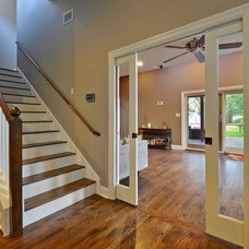 Traditional Staircase by GreenTex Builders LLC