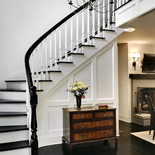 Staircase - traditional wooden curved staircase idea in New York