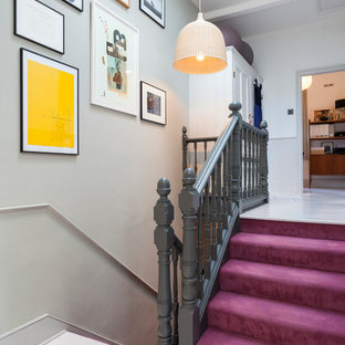 Inspiration for a scandinavian carpeted u-shaped staircase in London with carpeted risers.