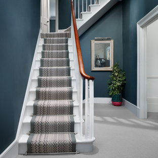 Design ideas for a contemporary painted wood staircase in Other with painted wood risers.