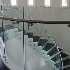Contemporary Staircase by Stair Service Inc.