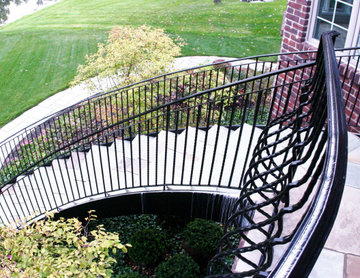 Curved Exterior Staircase with Wrought Iron Balcony Rail