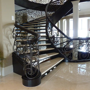 Example of a large classic acrylic curved open staircase design in London