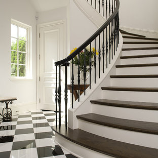 Inspiration for a mediterranean wooden staircase remodel in Minneapolis with painted risers