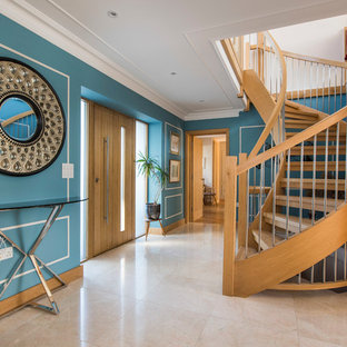 Photo of a classic wood curved wood railing staircase in Other.