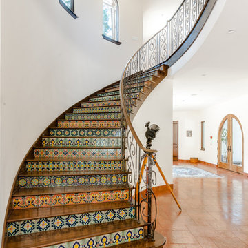 Curved Staircase with Spanish Tile Risers