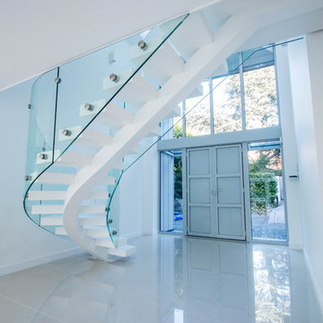 Curved White Middle Spine Staircase