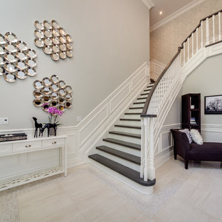 Example of a large trendy wooden l-shaped wood railing staircase design in Toronto with painted risers