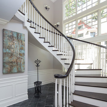 Custom Built Curving Two Tone Wood Staircase