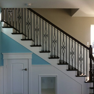 Photo of a medium sized traditional wood l-shaped staircase in Houston with painted wood risers.