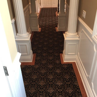 Staircase - mid-sized traditional wooden curved staircase idea in New York with carpeted risers