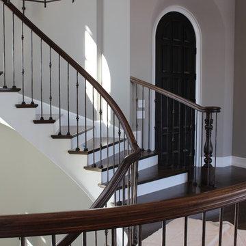 Custom Circular 3-Story Walnut Stair With Iron BalustersS