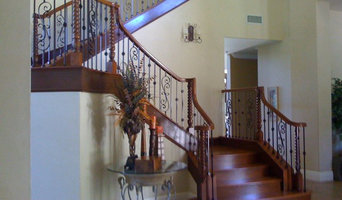 Custom Curved Maple Staircase with Iron Balusters
