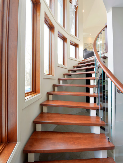 Lovely Trendy Wooden Curved Open Staircase Photo In Ottawa