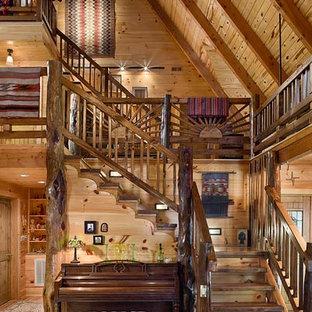 Ejemplo de escalera en L, rústica, grande, sin contrahuella, con escalones de madera