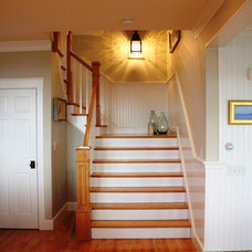Traditional Staircase by Thorson Restoration & Construction