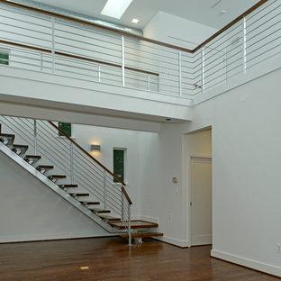 Inspiration för en mellanstor funkis flytande trappa i trä, med öppna sättsteg