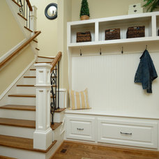 Traditional Staircase by Homeland Builders LLC
