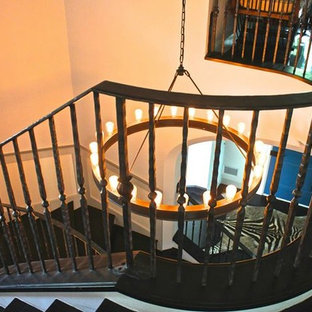 Inspiration for a mid-sized transitional painted curved metal railing staircase remodel in Austin with painted risers