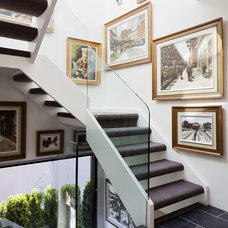 Contemporary Staircase by Natural Balance Home Builders