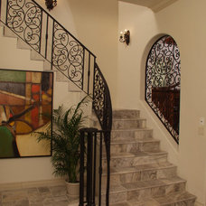 Mediterranean Staircase by Wells Design Contracting Inc.